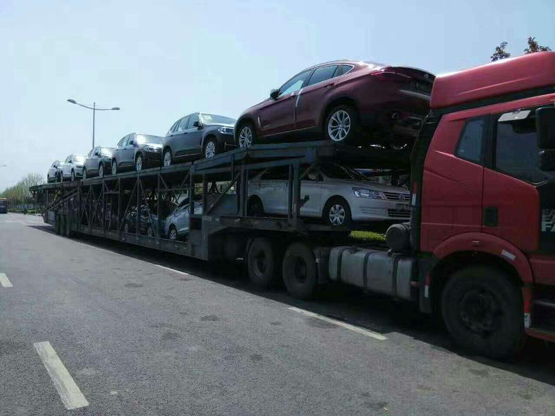 西安到乌鲁木齐插插网一辆轿车多少钱